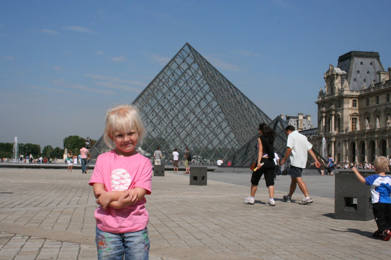 cute kid in front of Louvre pyramid