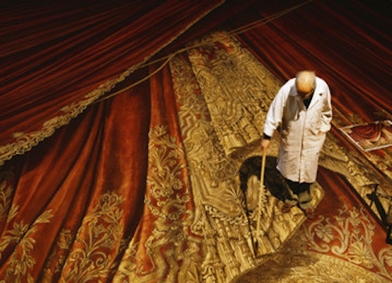 Painter painting the trompe l'oeil curtain
